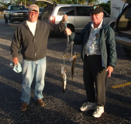 HCFC members Wayne Dukes and Chuck Giffin display their trout.