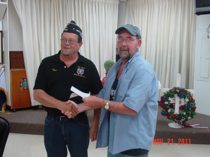 HCFC Treasurer Tom Taylor (right) presents VFW Post 9236 Men's Auxiliary President Tom Eskew with a $525 donation towards their Christmas Wish Program.