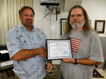 Member Rick Hall (left) accepts the January 2012