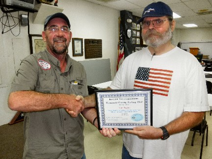 Member Tom Taylor (left) accepts the February 2012