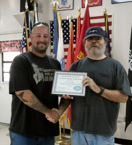 Member Mike Murphy (left) accepts the April 2012