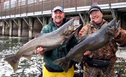 HCFC member Tom Taylor (left) with friend Chris Lee show some October Oswego River Salmon