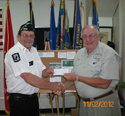HCFC President Rich LaBelle (right) presents VFW Post 9236 Men's Auxiliary President Tom Eskew with a $700 donation towards their Christmas Wish Program.