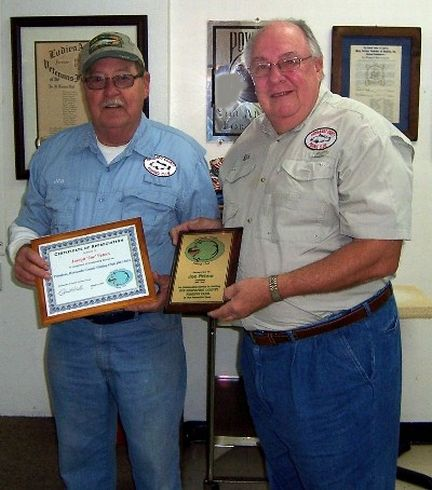 Past HCFC President Joe Peters (L) accept honors from
