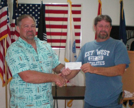 Rick Hall, Jr. accepts his Spring Tournament prize.  Rick took first place in the trout division.