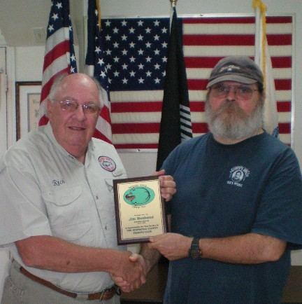 HCFC President Rich LaBelle (left) presnts outgoing Activities Director Jim Husband with a plaque honoring Jim's service to the club.