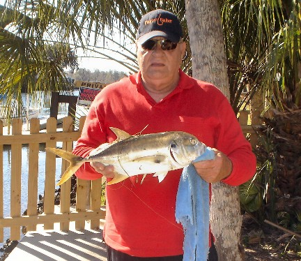 Member Chuck Phister displays his catch a nice Jack Crevalle